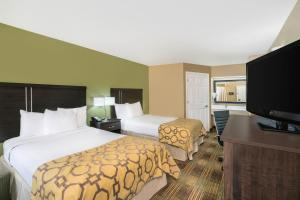 A bed or beds in a room at Baymont by Wyndham Prattville