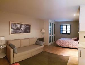 Zona de estar de Apartamentos Villa Cudillero