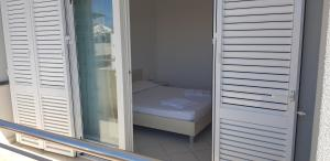 A bed or beds in a room at Apartments Biba