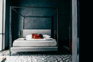 A bed or beds in a room at Native Hostels Austin