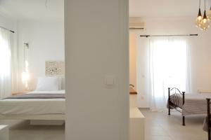 A bed or beds in a room at Veletas Rooms