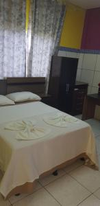 A bed or beds in a room at Imperial hotel
