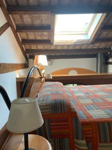 Ein Bett oder Betten in einem Zimmer der Unterkunft Le Residenze dei Serravallo
