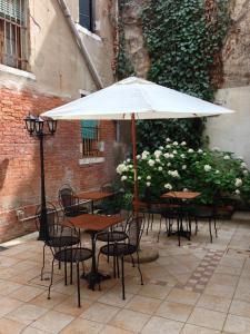 Uma varanda ou outra área externa em Al Portico Guest House