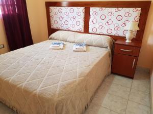Una cama o camas en una habitación de Costa Villa