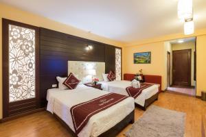 Un ou plusieurs lits dans un hébergement de l'établissement Sapa Elegance Hotel