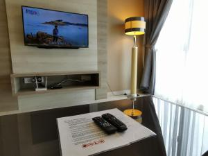 A television and/or entertainment center at Themework Homestay@Cameron Highlands