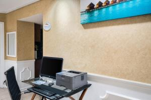 A television and/or entertainment center at Baymont by Wyndham Prattville