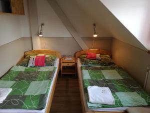 Postel nebo postele na pokoji v ubytování Hotel Kormoran