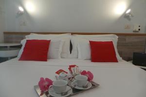 Letto o letti in una camera di Hotel Castelfidardo
