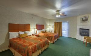A bed or beds in a room at Miners Inn