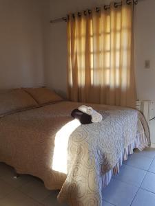 Cama ou camas em um quarto em Pousada Caminho do Mar