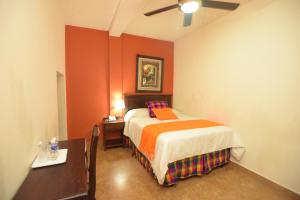 Cama o camas de una habitación en Hotel Posada de Don Juan