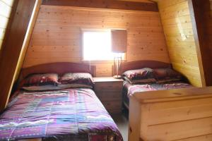 A bed or beds in a room at Falcon's Nest