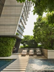 The swimming pool at or near Rosewood Bangkok