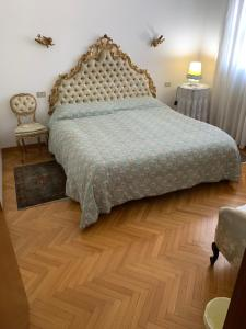 A bed or beds in a room at Villa Camilla