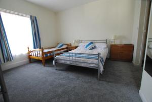 A bed or beds in a room at The Sandhill