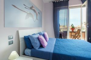Ein Bett oder Betten in einem Zimmer der Unterkunft A View on Cagliari