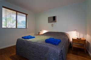 A bed or beds in a room at Potshot Hotel Resort