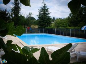 The swimming pool at or near Clos Paillé Charme & Caractere