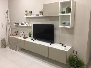 TV o dispositivi per l'intrattenimento presso Il profumo dei Sassi Holiday Home