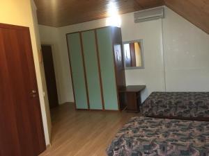 Кровать или кровати в номере Гостиница Ямал