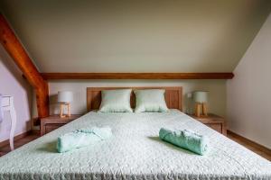 Un ou plusieurs lits dans un hébergement de l'établissement Le Verger du Mesnil