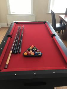 A pool table at 5 bed maisonette central Westkirby