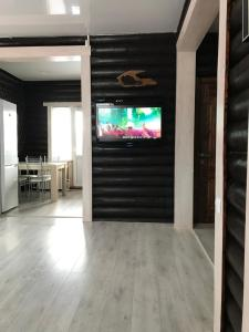 A television and/or entertainment center at Bungalo TeremOk