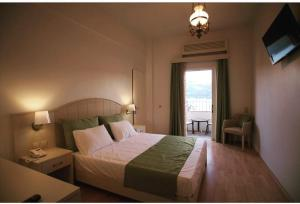 A bed or beds in a room at Mirini Hotel