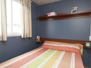 Cama o camas de una habitación en Camping Derby Loredo