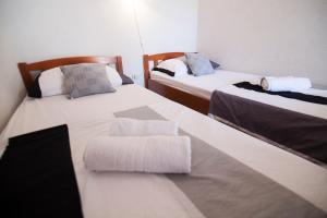 A bed or beds in a room at Apartment Teskera 1