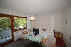 A bed or beds in a room at Pension Burk