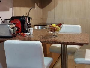 A kitchen or kitchenette at Apart - Ferroviario da Baixa