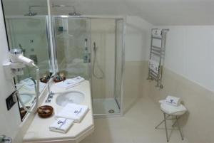 Ванная комната в Palazzo Foti Hotel