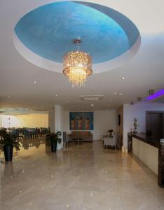 The lobby or reception area at Bellini Hotel
