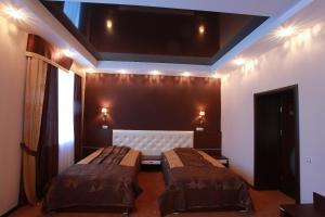 Кровать или кровати в номере Отель Губернский