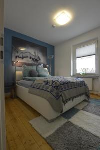 Ein Bett oder Betten in einem Zimmer der Unterkunft Alte Schule 2