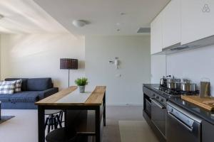A kitchen or kitchenette at A Cozy CBD Suite with Spectacular City Views