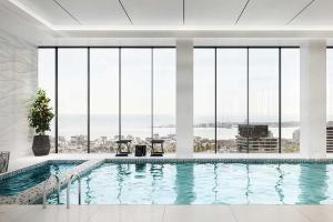 The swimming pool at or near A Cozy CBD Suite with Spectacular City Views