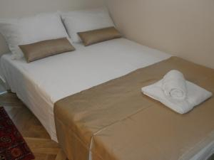A bed or beds in a room at Apartments Bohemia