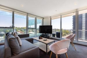 A seating area at Casey, South Yarra Private Apartments
