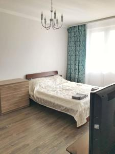 A bed or beds in a room at Apartments at the airport vnukovo