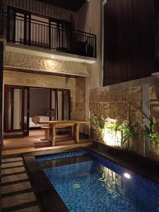The swimming pool at or near The Surya Kuta Villa