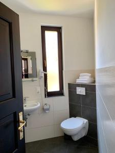 Ein Badezimmer in der Unterkunft Luisenhof