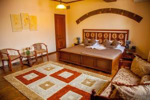 A bed or beds in a room at Platan