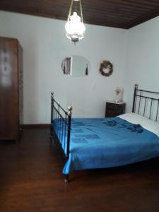 A bed or beds in a room at Vera's Traditional House