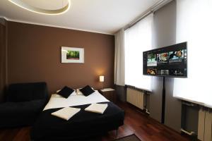Łóżko lub łóżka w pokoju w obiekcie Rainbow Apartments 1