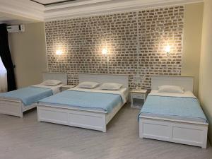 Кровать или кровати в номере Сити Отель