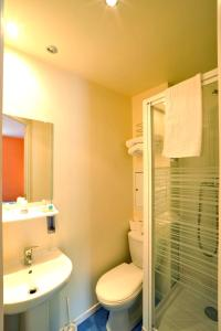 A bathroom at initial by balladins Roissy / Saint-Mard